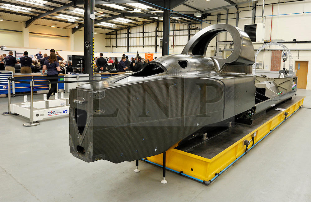 © Licensed to London News Pictures. 04/07/2013. Bristol, UK.  The actual carbon fibre bodywork of the Bloodhound Supersonic Car project at the official opening of the new technical centre in Avonmouth, Bristol.  The car is being built to go at 1000mph to break the land speed record, powered by a rocket and a Rolls Royce EJ200 jet engine with a Cosworth engine being used as a pump.  The record attempt will take place in South Africa and Bloodhound will be piloted by Wing Commander Andy Green from the RAF.  David Willetts, Minister for Science and Universities, took part in joining parts of the bodywork together.  04 July 2013.<br /> Photo credit : Simon Chapman/LNP