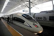 High Speed train linking Shanghai and Nanjing parked on a track at the rail station in Nanjing, China on 04 March, 2011.  In just a few years, China has built the world's longest high-speed rail network, named China Rail High-speed (CRH), and continues to expand despite accusations of technology pilfering and safety concerns. On July 23rd, 2011, two high-speed trains in eastern China collided due to supposed malfunctioning in the signaling system, killing 40 and injuring hundreds, meanwhile a slew of corruption scandals at China's rail ministry has surfaced recently.
