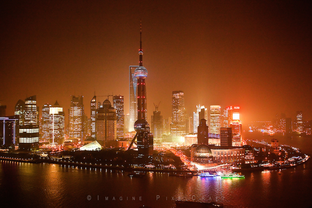 The lights of Shanghai's Pudong Financial district are a dazzling display. Shanghai is vying to become the financial center of the Asian region.