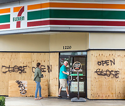October 7, 2016 - Florida, U.S. - Stores are opening up again, like this 7-11 on US 1 in North Palm Beach, Friday morning, October 7, 2016, after the passing of Hurricane Matthew. (Credit Image: © Lannis Waters/The Palm Beach Post via ZUMA Wire)
