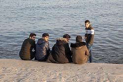 Friends Hanging Out At Baku Ocean Walkway