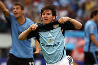 """Fotball<br /> Foto: Piko Press/Digitalsport<br /> NORWAY ONLY<br /> <br /> Argentina win over Uruguay (2-1) n their World Cup 2010 qualifying soccer match in Buenos Aires, October11, 2008<br /> Here Argentine player Lionel Messi reacts after he scored his team's first goal against Uruguay.<br /> In his t-shirt  """"I LOVE YOU DAD / FATHER"""""""