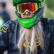 """Riders swarm Jackson Hole Mountain Resort during Friday Night Bikes. Mike Donovan, """"Mike D"""" gets the award for best beard within a full-face helmet."""
