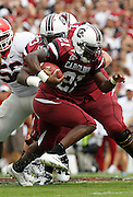 COLUMBIA - SEPTEMBER 11:  Tailback Marcus Lattimore #21 of the South Carolina Gamecocks runs with the ball during the game against the Georgia Bulldogs at Williams-Brice Stadium on September 11, 2010 in Columbia, South Carolina.  (Photo by Mike Zarrilli/Getty Images)