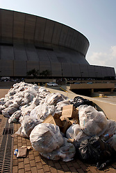 31st August, 2005. New Orleans Louisiana. Hurricane Katrina.  Garbage pils up outside 'Hell on earth' at The Superdome where over 20,000 refugees from hurricane Katrina are crammed into hellish conditions. <br /> Photo Credit: Charlie Varley/varleypix.com