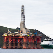 Greenpeace activists board a BP oil rig in Cromarty Firth to stop it from further oil drilling at sea, June 10th 2019, Cromarty, Scotland, United Kingdom. The oil rig 'Paul B. Loyd, Jnr', owned by Transocean, was due to head to BP's Vorlich field, 150 miles (241km) east of Aberdeen to drill for oil for BP. Change-over of Greenpeace climber.The occupation by Greenpeace activists subsequently delayed the departure for 5 days and 14 activists were arrested in the process. Greenpeace says that in an age of climate emergency BP should not be drilling for new oil but look for non-fossil fuel means of energy.