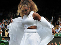 Tennis - 2019 Wimbledon Championships - Week Two, Tuesday (Day Eight)<br /> <br /> Women's Singles, Quarter-Final: Alison Riske (USA) vs. Serena Williams (USA)<br /> <br /> Serena Williams takes of her white jacket after coming on court on Centre Court.<br /> <br /> COLORSPORT/ANDREW COWIE