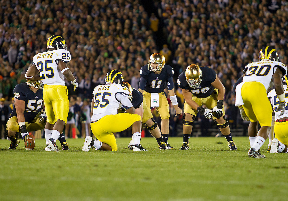 September 22, 2012:  Notre Dame quarterback Tommy Rees (11) changes the play at the line of scrimmage during NCAA Football game action between the Notre Dame Fighting Irish and the Michigan Wolverines at Notre Dame Stadium in South Bend, Indiana.  Notre Dame defeated Michigan 13-6.