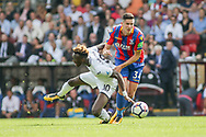Tammy Abraham of Swansea city is fouled by Martin Kelly of Crystal Palace ®. <br /> Premier League match, Crystal Palace v Swansea city at Selhurst Park in London on Saturday 26th August 2017.<br /> pic by Kieran Clarke, Andrew Orchard sports photography.