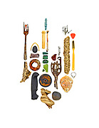 Driftwood riddled with shipworm holes, sea glass, oyster shell, beach stones, bird leg bone, seaweed, metal fork, spring, metal spoon, plastic knife handle, soda can tab, toothbrush, guitar pick, and miscellaneous plastic scraps.