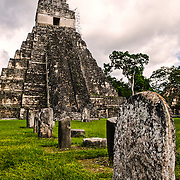 Temple 1 (Temple of the Giant Jaguar) with stelas in the Main Plaza in the Tikal Maya ruins in northern Guatemala, now enclosed in the Tikal National Park.
