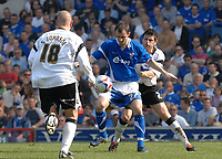 Photo: Ashley Pickering.<br /> Ipswich Town v Derby County. Coca Cola Championship. 14/04/2007.<br /> Ipswich goal scorer Francis Jeffers (blue) holds off Marc Edworthy of Derby