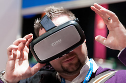 © Licensed to London News Pictures. 15/03/2016. London, UK. A man tries a virtual reality headset. Technology fans visit the Wearable Technology Show at the Excel Centre.  The largest dedicated event for connected technology, the show features innovative products from start-ups as well as products from major technology companies and includes the latest in virtual reality and augmented reality devices and software. Photo credit : Stephen Chung/LNP