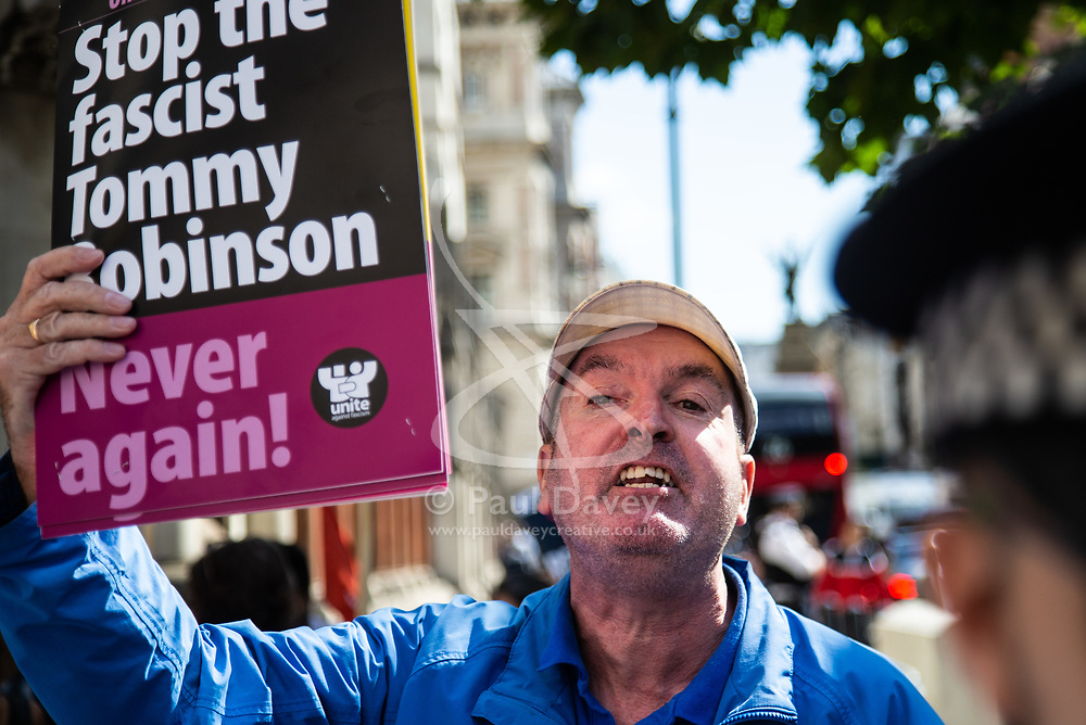 A protester from Stand Up To Racism demonstrates outside The Royal Courts of Justice in London as an appeal by lawyers representing right wing activist Tommy Robinson win his release on bail ahead of a new hearing to be held at The Old Bailey, following his imprisonment on contempt of court charges. London, August 01 2018.