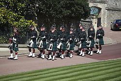 A detachment of the 4th Battalion The Royal Regiment of Scotland arrive at Windsor Castle, Berkshire, ahead of the funeral of the Duke of Edinburgh. Picture date: Saturday April 17, 2021.