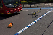 "The crushed wreckage of a ladies bike lies on the surface of the A3 Kennington Park Road at the junction with A23 Kennington Road, south London. A woman in her twenties was taken to King's College Hospital with a leg injury after a crash between a bus and a cyclist this morning. Emergency services were called to Kennington Park Road at 9.30am. A London Buses statement reads: ""At around 09:30 this morning a route 333 bus, operated by London General, was involved in a collision with a cyclist .."""