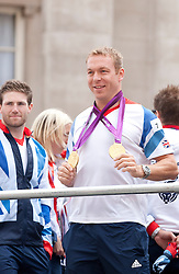 © Licensed to London News Pictures. 10/09/2012. LONDON, UK. Cyclist Sir Chris Hoy displays the two gold medals he won at the 2012 London Olympics for spectators near Bank Station during a parade for Olympic and Paralympic athletes in London today (10/09/12)  . Photo credit: Matt Cetti-Roberts/LNP