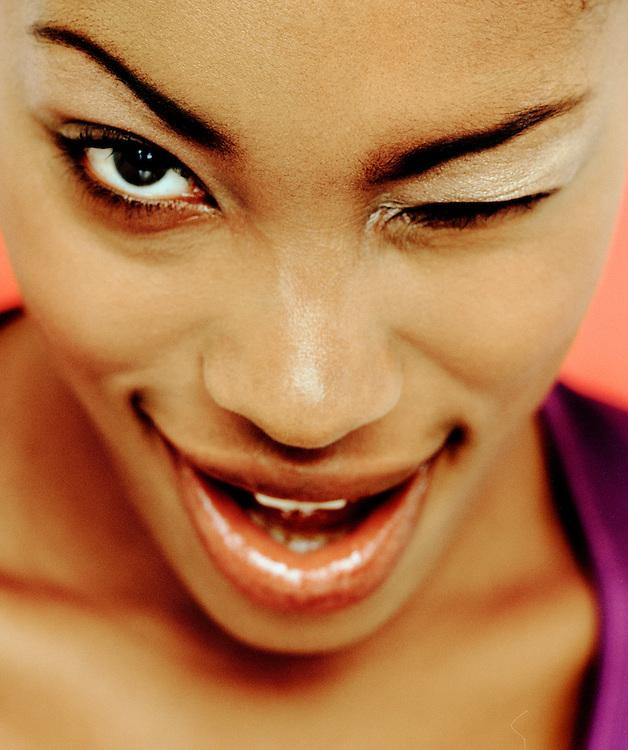 Portrait of a female winking.