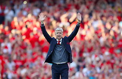 Arsenal manager Arsene Wenger salues the fans after the final whistle