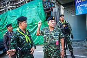 27 OCTOBER 2012 - SUNGAI KOLOK, NARATHIWAT, THAILAND:     Thai Army command officers at the scene of a car bombing that destroyed a prominent hotel one block from the Malaysian border in Sungai Kolok, Thailand. The officers were visiting on 27 Oct during the Muslim holiday of Eid al-Adha, the bomb was detonated in July 2012. Sungai Kolok has been a center of extremist violence. Several car bombs have been detonated in the city, which is on the Malaysian border and very popular with Malaysian tourists. More than 5,000 people have been killed and over 9,000 hurt in more than 11,000 incidents, or about 3.5 a day, in Thailand's three southernmost provinces and four districts of Songkhla since the insurgent violence erupted in January 2004, according to Deep South Watch, an independent research organization that monitors violence in Thailand's deep south region that borders Malaysia.   PHOTO BY JACK KURTZ