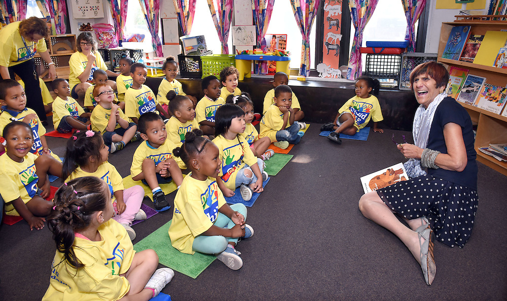 Photo by Mara Lavitt -- Special to the Hartford Courant<br /> August 18, 2015 <br /> U.S. Rep. Rosa DeLauro (D-3) visited with the 3-5 year-old class and read them a book at the Sleeping Giant Day Care in Hamden and then participated in a panel discussion to accentuate the need for higher pay for day care workers. DeLauro reacts when one of the children asked if she was named Rosa because she takes care of roses.