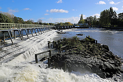 © Licensed to London News Pictures. 03/11/2013. Gushing water at Teddington weir this morning. The annual Thames Draw off has got underway. The opening of the weir at Richmond Lock allows the water level between Richmond and Teddington Locks to go down dramatically at low tide, exposing huge swathes of normally covered riverbed. During the Draw Off period, maintenance will take place on the weirs and an inspection of the riverbed will take place Credit : Rob Powell/LNP
