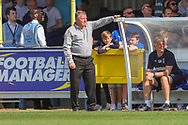 AFC Wimbledon manager Wally Downes leaning against the dug out during the EFL Sky Bet League 1 match between AFC Wimbledon and Bristol Rovers at the Cherry Red Records Stadium, Kingston, England on 19 April 2019.