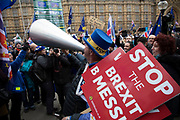 Anti Brexit pro Europe demonstrator Steve Bray decides to sing his songs with his giant megaphone after police force him to turn off his speaker in Westminster on the day of the 'meaningful vote' when MPs will back or reject the Prime Minister's Brexit Withdrawal Agreement on 15th January 2019 in London, England, United Kingdom.