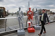 ActionAid's International Safe Cities for Women Day on Millenium Bridge,  London.<br /> Picture date: Thursday May 19, 2016. A third of the mannequins featured in the installation will be marked in red, to represent the one in three women who experience violence in their lifetimes. But behind every statistic is a real woman, and on each mannequin are quotes from women around the world telling their experience of urban violence and the stories behind the statistics. ActionAid is campaigning for the UK government to commit to increasing the proportion of aid going directly to women's groups working on the frontline in poor communities. (photo by Andrew Aitchson/ActionAid)