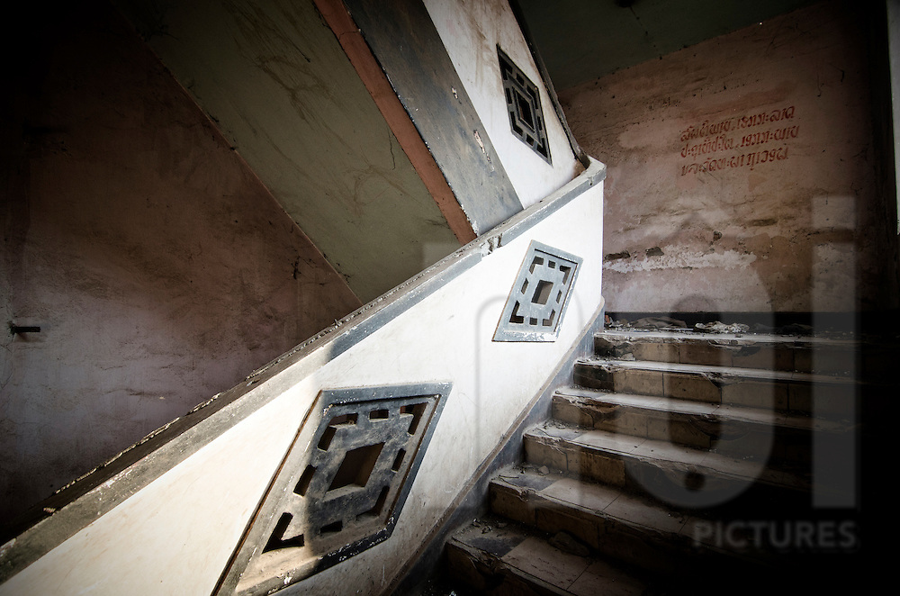 Abandoned Sengchaleun cinema, Savannakhet, Laos, Asia. Interiors are in complete decay and very messy. Empty staircase