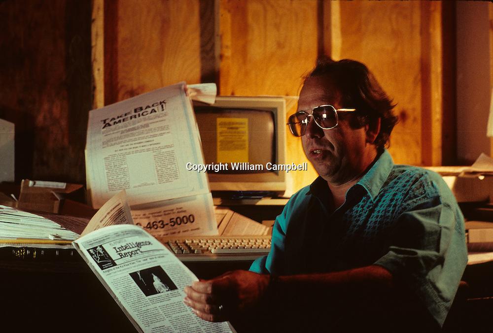 Thom Robb, head of the Knights of the Klu Klux Klan in his office in Zink, Arkansas. 5/92