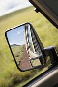 View of the reflection in the Side view mirror of a 4x4 safari car, Ngorongoro Crater, Tanzania
