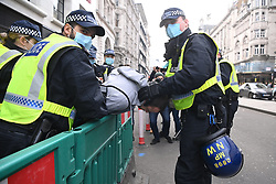 © Licensed to London News Pictures. 28/11/2020. London, UK. Police officers arrest a protester for taking part in the Unite For Freedom Anti Covid-19 lockdown demonstration. Organised by the group Stand Up X, the protesters are against the current lockdown regulations and anti-vaccination for the Covid-19 disease. Photo credit: London News Pictures