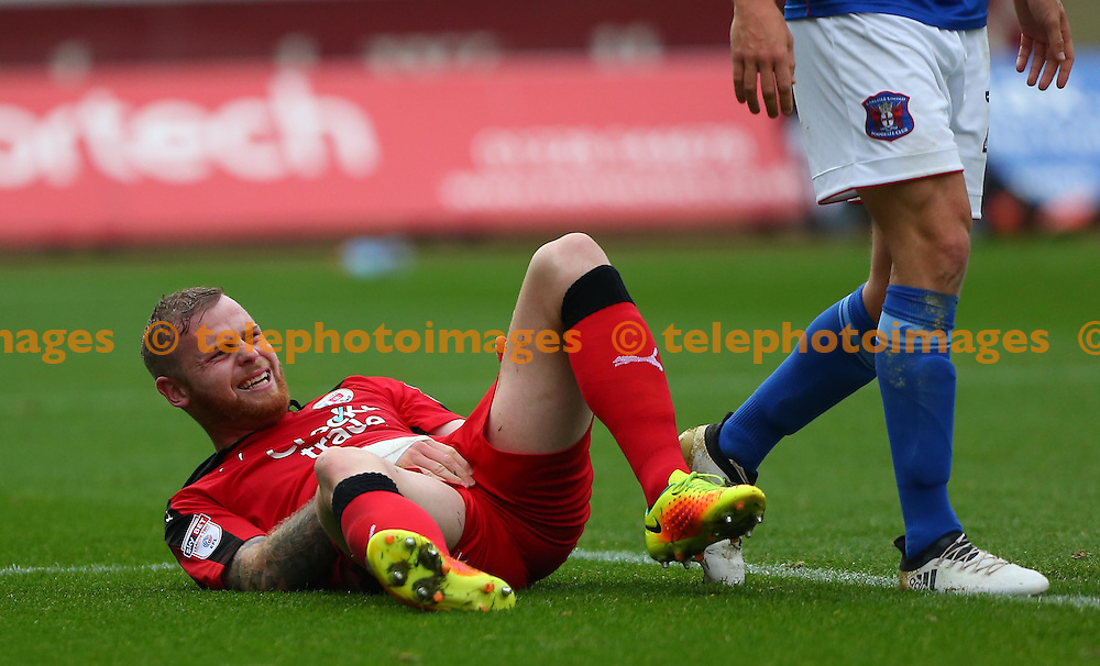 Crawley's Mark Connolly grimaces after a tough challenge during the Sky Bet League 2 match between Carlisle United and Crawley Town at Brunton Park in Carlisle. October 29, 2016.<br /> James Boardman / Telephoto Images<br /> +44 7967 642437