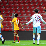 Referee's Bunyamin GEZER (R) show the red card to Galatasaray's Colin Kazim RICHARDS (2ndL) during their Turkish superleague soccer derby match Galatasaray between Trabzonspor at the TT Arena in Istanbul Turkey on Sunday, 10 April 2011. Photo by TURKPIX