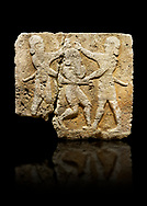 Photo of Hittite relief sculpted orthostat stone panel of Herald's Wall Limestone, Karkamıs, (Kargamıs), Carchemish (Karkemish), 900-700 B.C. Anatolian Civilisations Museum, Ankara, Turkey.<br /> <br /> This relief tells the story the killing of Humbaba, protective deity of the cedar forests, by Gilgamesh and Enkidu. The figures standing on both sides hold, with one hand, the arms of the figure in the middle transversally while they stab the dagger on the head of the figure.  <br /> <br /> Against a black background. .<br />  <br /> If you prefer to buy from our ALAMY STOCK LIBRARY page at https://www.alamy.com/portfolio/paul-williams-funkystock/hittite-art-antiquities.html  - Type  Karkamıs in LOWER SEARCH WITHIN GALLERY box. Refine search by adding background colour, place, museum etc.).<br /> <br /> Visit our HITTITE PHOTO COLLECTIONS for more photos to download or buy as wall art prints https://funkystock.photoshelter.com/gallery-collection/The-Hittites-Art-Artefacts-Antiquities-Historic-Sites-Pictures-Images-of/C0000NUBSMhSc3Oo