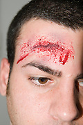 Mock up of a car crash victim who banged his head on the steering wheel. Injury created with make up.