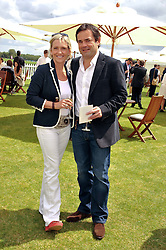 WILL CARLING and his wife LISA at the Cartier Queen's Cup Polo Final, Guards Polo Club, Windsor Great Park, Berkshire, on 17th June 2012.