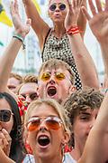 Fans let off flares as Liam Gallagher plays the Pyramid Stage - The 2019 Glastonbury Festival, Worthy Farm, Glastonbury.