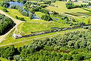 Nederland, Gelderland, Duiven, 09-06-2016; Groessen, natuurgebied Kandia. Goederentrein op Betuweroute, tunnel onder Pannerdens kanaal.<br /> Tunnel Betuweroute, freight railway, Pannerdensch channel (Lower Rhine) on the horizon.<br /> <br /> luchtfoto (toeslag op standard tarieven);<br /> aerial photo (additional fee required);<br /> copyright foto/photo Siebe Swart