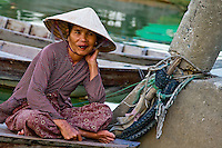 Local woman sitting on her boat in Hoi An.
