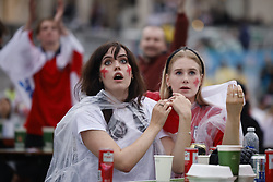 © Licensed to London News Pictures. 11/07/2021. London, UK. England supporters react to the EURO 2020 final between Italy and England as they watch the giant screens in Tragalgar Square in central London. Photo credit: Peter Macdiarmid/LNP