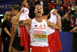 Poland's Marcin Lewandowski celebrates after winning gold at the Men's 1500m Final during day three of the European Indoor Athletics Championships at the Emirates Arena, Glasgow.