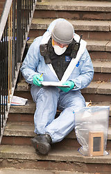 © Licensed to London News Pictures 07/03/2021. Greenwich, UK. Met police forensics outside the front of the property. Police and London Fire Brigade forensic teams continue to work at the scene of a fatal fire that killed a five year old boy and has left the rest of his family in hospital. The property in Greenwich, South East London is still cordoned off today with flowers and balloons being placed at the scene. Photo credit:Grant Falvey/LNP