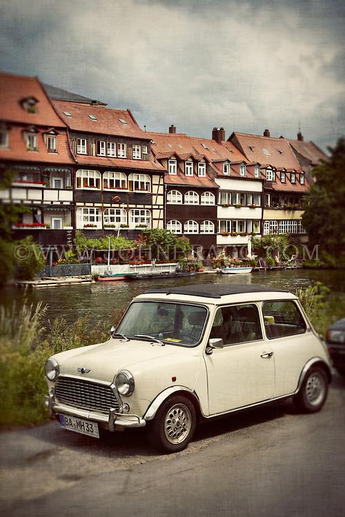 A vintage Mini Cooper, Regnitz River in Bamberg, Germany.