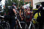"Lauren Digioia, 27, and Jack Amico, 24, of Occupy Wall Street, speak out against Bank of America during the 2012 Democratic National Convention on Wednesday, September 5, 2012 in Charlotte, NC. ""We travel to wherever our voice are heard,"" Amico said."