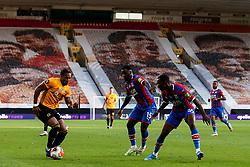 Adama Traore of Wolverhampton Wanderers takes on Jeffrey Schlupp and Tyrick Mitchell of Crystal Palace - Mandatory by-line: Robbie Stephenson/JMP - 20/07/2020 - FOOTBALL - Molineux - Wolverhampton, England - Wolverhampton Wanderers v Crystal Palace - Premier League