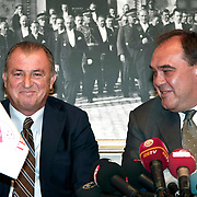 Turkish national soccer team new coach Fatih Terim (L) attend a signing ceremony in Istanbul, Turkey on 22 August 2013. Turkish Football Federation has agreed a 1-year contract with Fatih Terim for Turkish A National Team Head Coach. Terim signed his contract today in TFF Headquarters, Istanbul with the participation of TFF President Yildirim Demirören, TFF Executive Board and TFF General Secretary. Fatih Terim will take charge of Turkey for the rest of their 2014 FIFA World Cup qualifying campaign, starting next month, while remaining in his role as coach of Galatasaray. Photo by TURKPIX