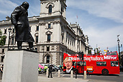 On the day that Britains new Conservative Party Prime Minister, Boris Johnson enters Downing Street to begin his government administration, replacing Theresa May after her failed Brexit negotiations with the European Union in Brussels, a bus tours parliament Square with a hashtag about Johnsons reputation of aneconomy with the truth, on 24th July 2019, in Westminster, London, England.
