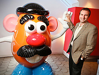 Fred Poston, Vice President of Operations, hams it up with Hasbro's Mr. Potato Head in The Hub offices in Burbank, CA.  July 28, 2010. Photo by David Sprague